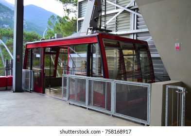 OLYMPOS, ANTALYA, TURKEY - SEPTEMBER 27, 2017:  Open, empty cable car at a lower station of Olympos Teleferik waiting for it's passengers to lift them to the upper station on top of Tahtali mountain.