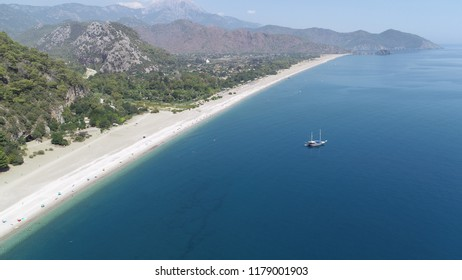 Olympos is the biggest beach. 4 km long. It looks perfect from the air.
