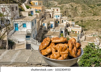 OLYMPOS, KARPATHOS, GREECE – april 22, 2008 : baking special bread for Easter  come out of the oven