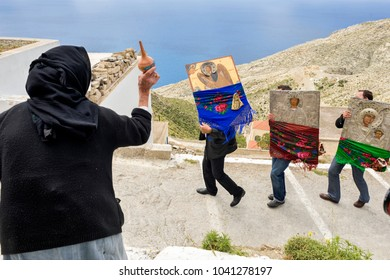 OLYMPOS, KARPATHOS island – april 29, 2008 : procession of Easter Tuesday. a village elder throws holy water on the icons
