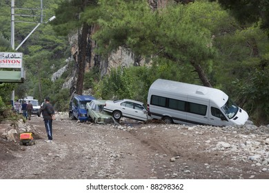 OLYMPOS, TURKEY - OCTOBER 14: Crashed cars and people in the woods after flood disaster on October 14, 2009 in Olympos, Turkey, Asia. The floods destroy  roads and houses and swept away about 50 cars.