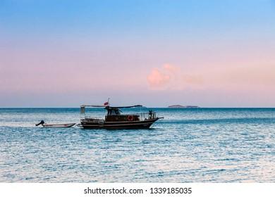 OLYMPOS, TURKEY – SEPTEMBER 28, 2011: Fishing boat on Mediterranean Sea in Olympos, Turkey.
