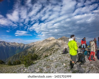 OLYMPUS NATIONAL PARK, GREECE - JUNE, 2019: Tourists climbing the Olympus mountain from the Mouson plateau 2700meters to Prophet Helias and Mytikas peak 2917meters in Pieria, Macedonia, Greece, Europe