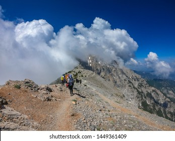 OLYMPUS NATIONAL PARK, GREECE - JUNE, 2019: Tourists climbing the Olympus mountain in Greece, Europe