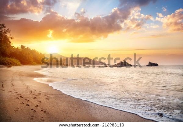 Om beach at orange sunrise sky in Gokarna, Karnataka, India