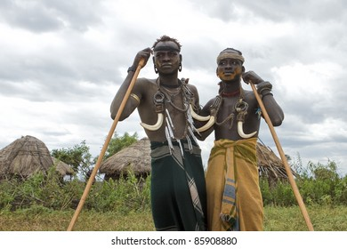 OMA VALLEY, ETHIOPIA - AUG 11: Mursi men posing in the village, the ethnic groups in the The Omo valley Could disappear Because of Gibe III hydroelectric dam on Aug 11, 2011 in Omo Valley, Ethiopia.