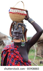 OMA VALLEY, ETHIOPIA - AUG 11: Mursi woman posing in the village,the ethnic groups in the The Omo valley Could disappear Because of Gibe III hydroelectric dam on Aug 11, 2011 in Omo Valley, Ethiopia.