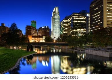 Omaha, NE - October 11, 2018: An evening view of the Omaha, Nebraska skyline from the Gene Leahy Mall. (0545)