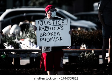 Omaha, Nebraska / USA - 05/29/2020: Protesters gather at 72nd and Dodge in Omaha Nebraska to protest the killing of George Floyd, an African-American man from Minnesota