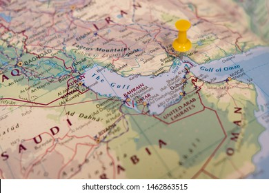 Oman, Middle East - Circa July 2019: Yellow map pin seen located at the Straight of Hormuz, a politically sensitive area in the Persian gulf. Out of focus neighbouring Iran and Oman states are seen.