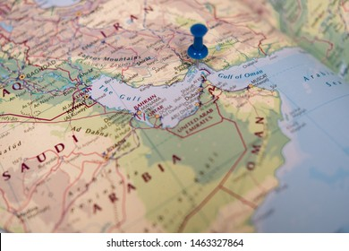 Oman, Middle East - Circa July 2019: Shallow focus of a blue pin map seen located at the Straight of Hormuz, a politically sensitive region in the Persian gulf. Other countries are also visible.