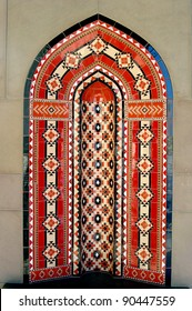 Oman Muscat. Islamic architectural artwork arch wall background in the Al Qubrah Mosque in Muscat, Oman.