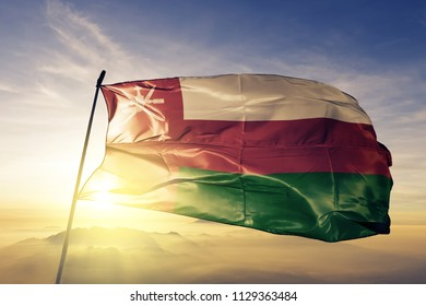 Oman national flag textile cloth fabric waving on the top