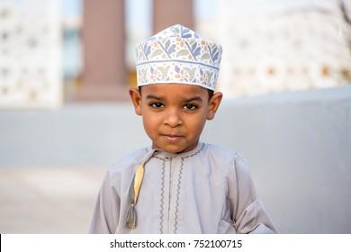 Omani boy wearing dish dasha