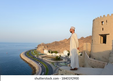 Omani man standing on top of mutra fort, Oman