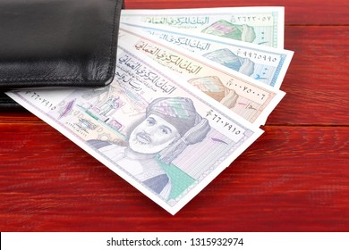 Omani Rial in the black wallet