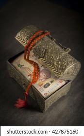Omani Riyals in an ornamental, vintage treasure box. 'Islamic Finance' - creative concept.