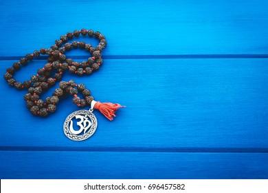 Om/Aum symbol. blue background