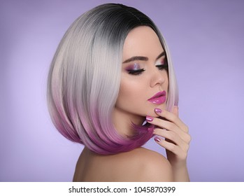 Ombre bob short hairstyle. Beautiful hair coloring woman. Trendy haircuts. Purple Manicured nails. Blond model with short shiny hairstyle. Concept Coloring Hair.
