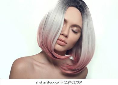 Ombre bob short hairstyle. Beautiful hair coloring woman. Fashion Trendy haircut. Blond model with short shiny hairstyle. Concept Coloring Hair. Beauty Salon.