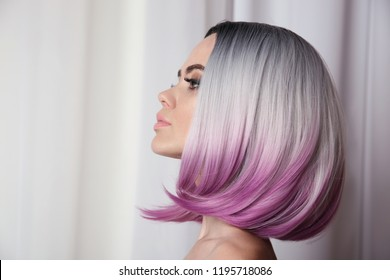 Ombre bob short hairstyle. Beautiful hair coloring woman. Trendy puprle haircut. Blond model with short shiny haircuts. Makeup. Beauty Salon Background.