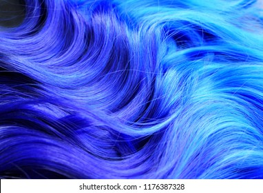 Ombre hair dying black to blue, with  turquoise highlights, bright vivid colors, such as turquoise and blue, salon advertising, hair texture
