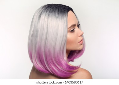 Ombre purple bob short hairstyle. Beautiful hair coloring woman. Trendy haircuts. Blond model with short shiny hairstyle. Concept Coloring Hair. Beauty Salon.