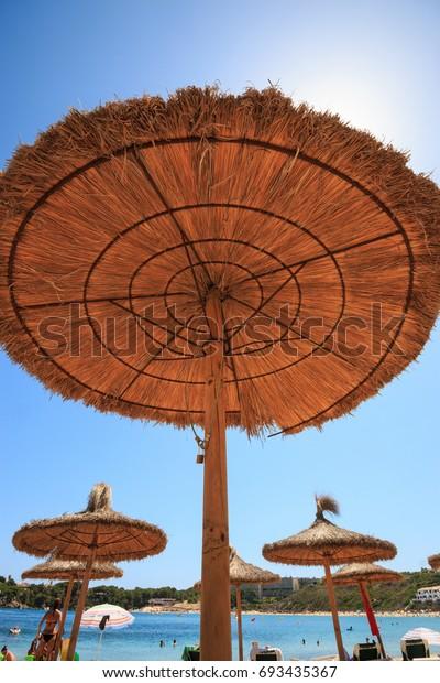 Ombrelloni Per La Spiaggia.Ombrelloni Di Paglia Sulla Spiaggia Stock Photo Edit Now