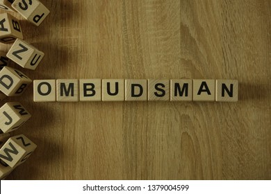 Ombudsman word from wooden blocks on desk