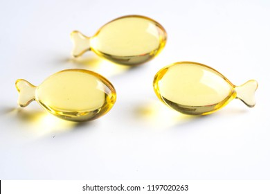omega capsules on white background fish shape