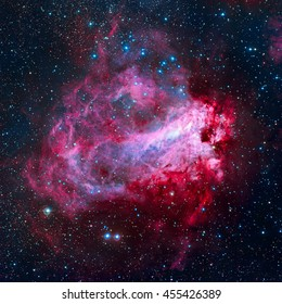 The Omega Nebula, also known as the Swan Nebula, Checkmark Nebula, and the Horseshoe Nebula (Messier 17, M17) is an region in the constellation Sagittarius. Elements of this image furnished by NASA.