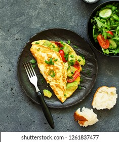 omelet with avocado, tomatoes and cheese for breakfast.