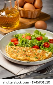 Omelet with cheese and lettuce and tomato salad.