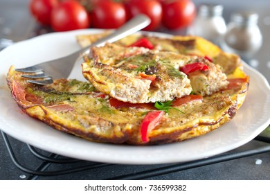 Omelet with eggs, tomato and dill on rye bread
