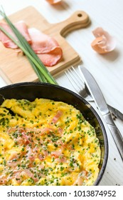 omelet with ham in a pan