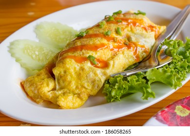 omelet with sausage on white plate