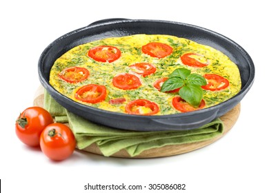 Omelet with tomatoes, cheese and basil in frying cast-iron pan