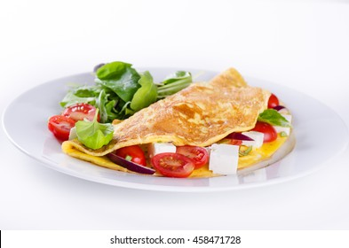 Omelette with cherry tomatoes and feta cheese on white