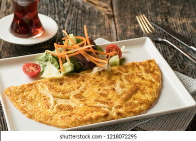 Omelette with cup of tea. Turkish breakfast menu. Menemen and egg meal.
