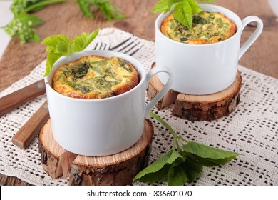 Omelette with goutweed in two white ceramic cups