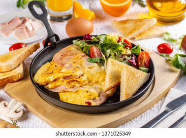 Omelette with ham and cheese in fry pan