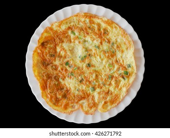 Omelette on white plate isolated on black background (with clipping path)