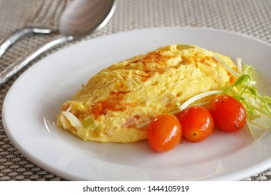 Omelette is pancakes of eggs, The good healthy breakfast in the morning, Selective focus and free space for text, healthy food background ideas concept.