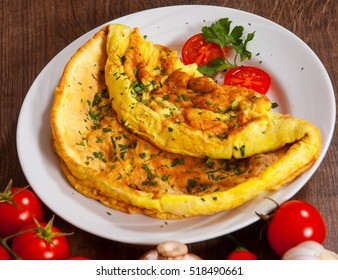 omelette in a plate on wooden table