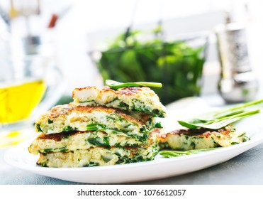 omelette with spinach leaves, diet food, omelette on plate