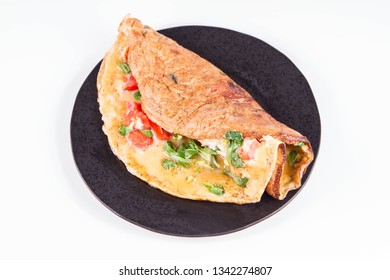 Omelette with tomatoes and fresh corn salad on a white background