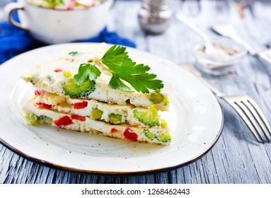 omelette with vegetables on plate on a table