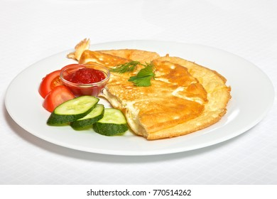 omelette with vegetables and souce on white background