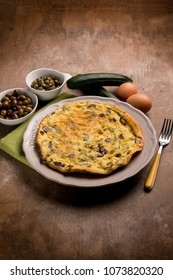 omelette with zucchinis black olives and capers