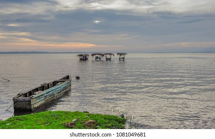 Ometepe Island, Nicaragua, Central America - May 5, 2017: Sunset with a small boat on the shore of Lake Cocibolca